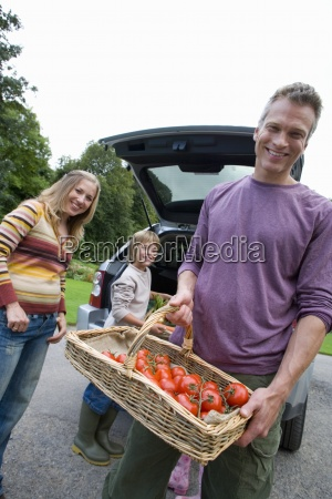 man with basket of tomatoes by