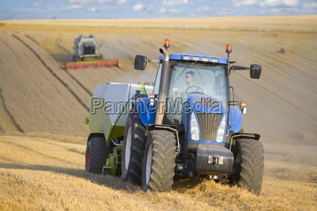 tractor and straw baler in wheat