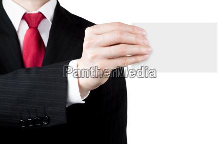 biznes czlowiek trzymajac biala karte