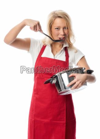 kobieta w fartuch gospodarstwa pot i