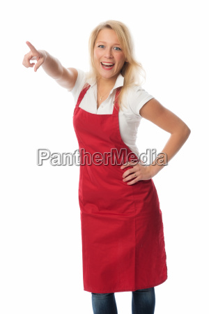 woman with red apron pointing at