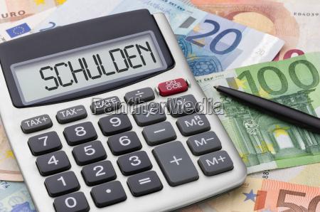 kalkulator z banknotami dlug