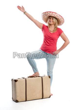 woman with sombrero and travel suitcase