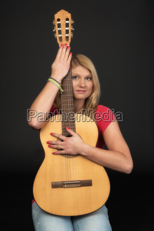 dreamy woman holding a guitar