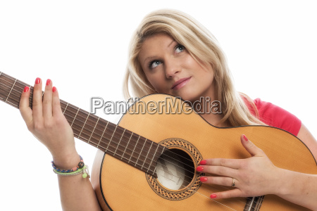 blonde woman playing on a guitar