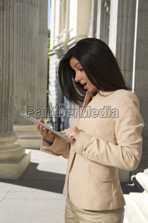 surprising businesswoman with tablet