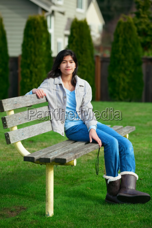 young biracial teen girl relaxing outdoors