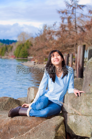 happy young teen girl face upturned