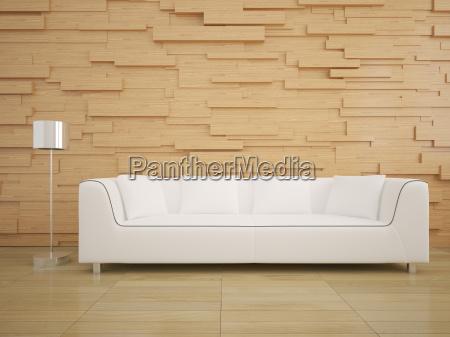 sofa i drewniana sciana w salonie