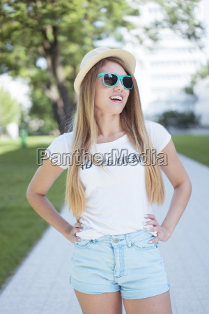 attractive girl wearing trendy outfit at