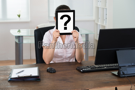 businesswoman with question mark sign