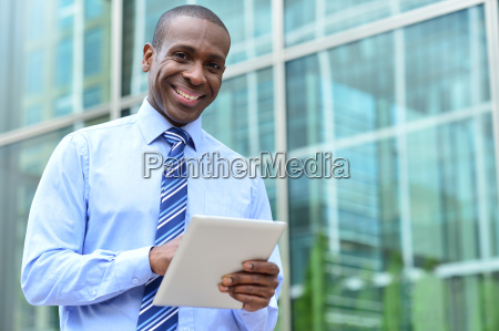 happy male executive posing to camera