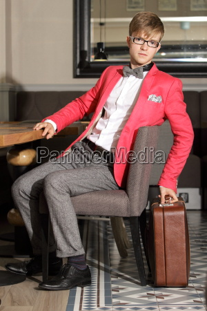 young handsome stylish man with suitcase