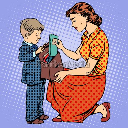 matka pomaga dziecku przyjsc do szkoly