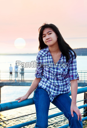 young teen biracial asian girl sitting