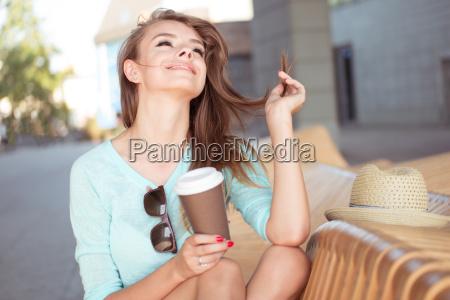 happy pretty girl with coffee sitting
