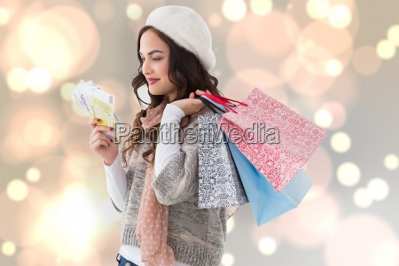 composite image of happy brunette holding