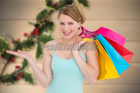 composite image of smiling woman presenting