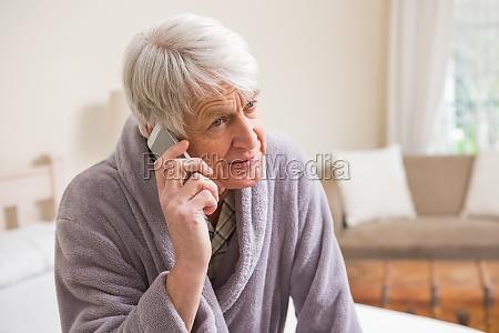 senior man making a phone call