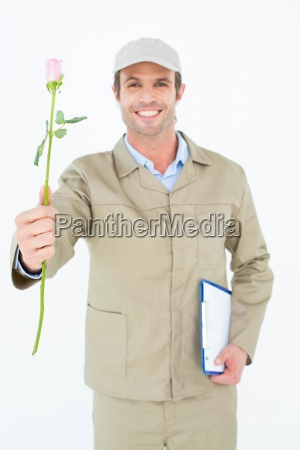 delivery man with clipboard offering rose