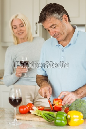 happy mature couple having red wine