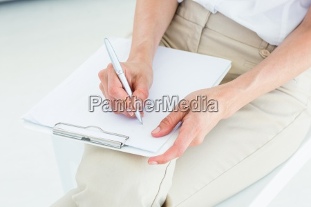 therapist taking notes