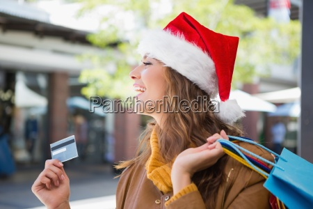 smiling woman with santa hat and