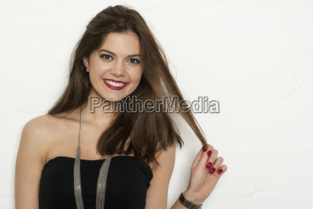 brunette woman with red lips playing