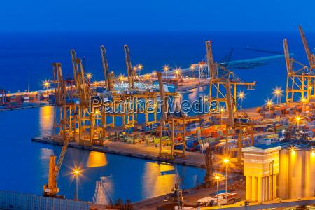 sea cargo port at night in