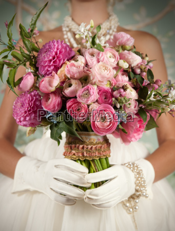 stylized bride holding beautiful bouquet