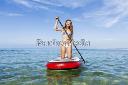 kobieta womane baba tablica wioslowanie bikini
