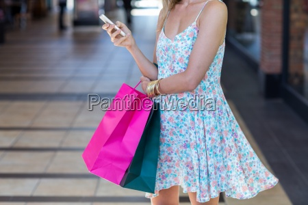 woman walking with shopping bags and