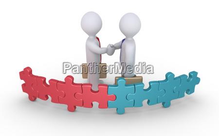 umowa biznesmenow dwoch zespolow