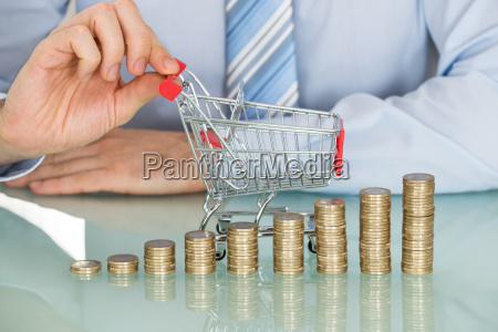 businessman with stacked coins and small