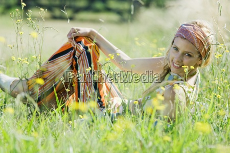 young woman sitting in tall grass