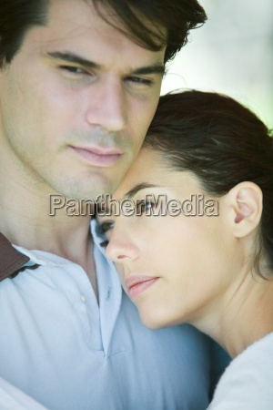 young couple woman putting head on