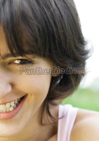 young woman laughing cropped portrait