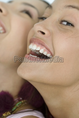 two young female friends laughing one