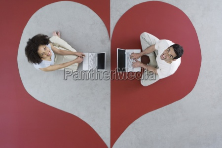 man and woman sitting on large
