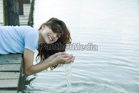 woman leaning off edge of dock