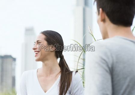young woman laughing with young man