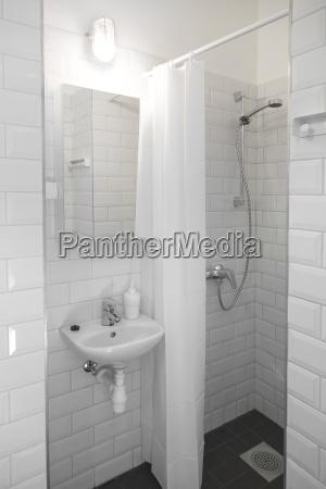 small compact white bathroom interior