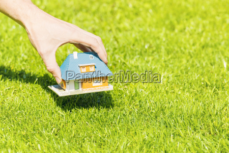 new home concept hand putting house