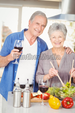 portrait of senior woman preparing salad