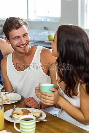 man looking at woman while having
