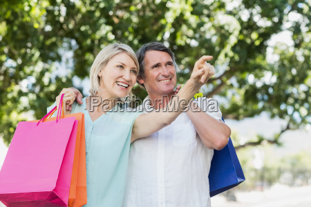 woman pointing to happy man with