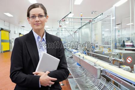 portrait confident businesswoman with laptop at