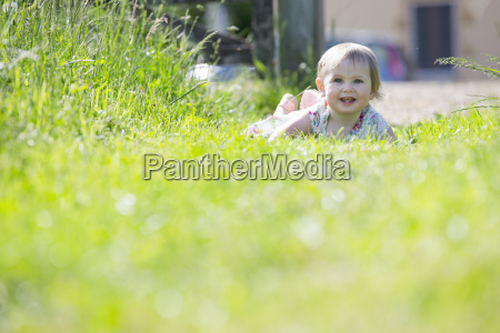 portrait of smiling baby crawling on