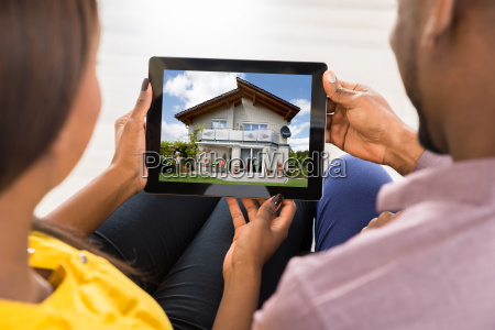 young couple using digital tablet