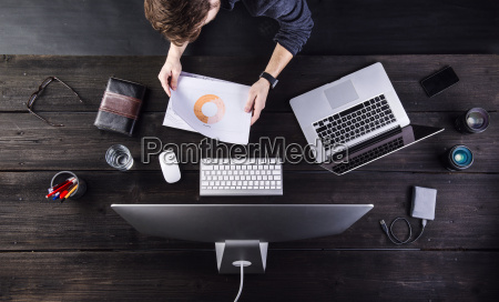 man working at desk with computer